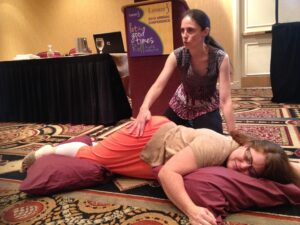Melinda Delisle teaching massage