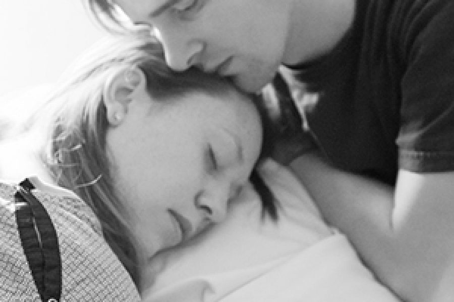 Laboring Mother Supported by her husband